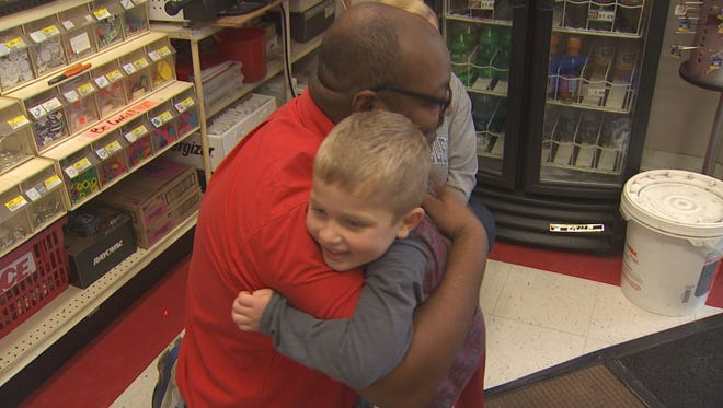 Granderson Miller, 5, hugs Ace Hardware store employee Jason Coleman after Granderson received a special gift.