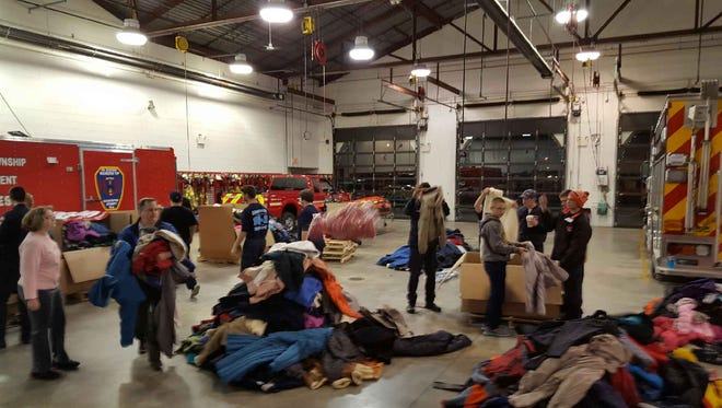 Washington Township Fire Explorers collected nearly 1,200 coats for Angels of God Clothing Closet in Pitman.