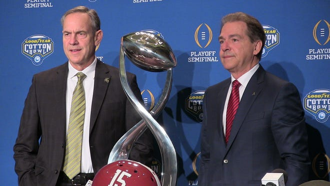 Mark Dantonio and Nick Saban pose with the Goodyear Cotton Bowl Classic trophy Wednesday.