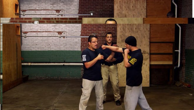 A screenshot from a Force Effects Training video, featuring owners Cesar Olavarria (left) and Edwin Pantoja (background).