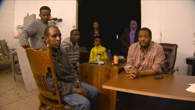 Some of the Somali workers from Cargill and their translator
