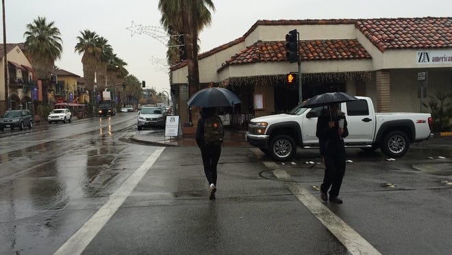 People opened up their umbrellas this week as a pair of storms hit the Coachella Valley. Rainfall for the season is above average, forecasters say.