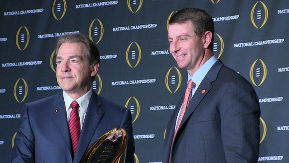 Nick Saban and Dabo Swinney post with national championship