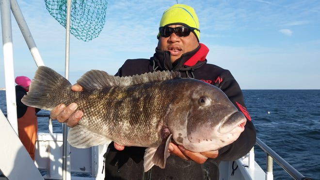 Skip Reese of Hamilton with an 11-pound, 5-ounce blackfish he caught on the Ocean Explorer on Tuesday, Jan. 12.