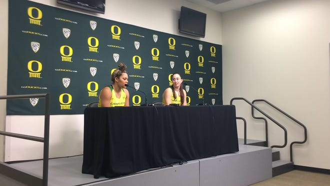 Oregon women's basketball players Kat Cooper (left) and Maite Cazorla address the media Sunday after the Ducks beat Arizona.
