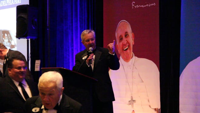 An auctioneer from Max Spann Real Estate and Auctions in Clinton conducted the auction of the Fiat 500L that Pope Francis used when he visited Philadelphia last September.