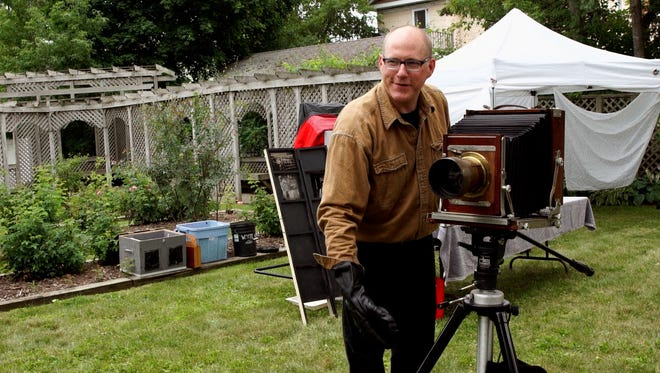 """Marshfield School District art teacher Eric Nelson at work with his old-school camera equipment. He and Margot Jones, his wife and creative partner, are featured in the documentary """"Pass the Canvas."""""""