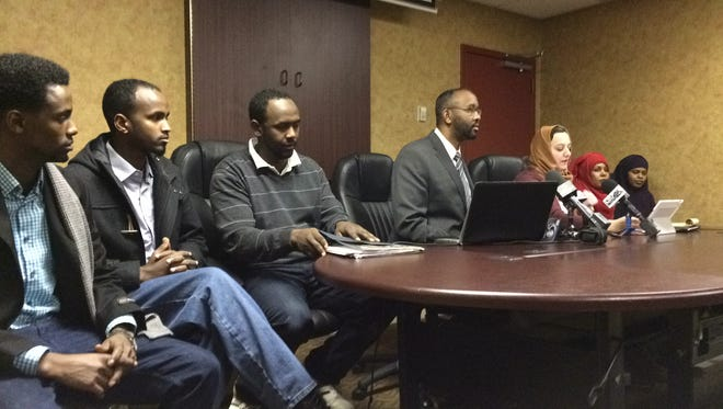 Former Ariens Co. employees joined Council on American-Islamic Relations Minnesota Executive Director Jaylani Hussein (center), and CAIR civil rights attorney Maha Sayed (third from right), in announcing the council's intention to file a religious discrimination complaint with the Equal Employment Opportunity Commission over the Brillion company's unwillingness to accommodate Muslim prayers during the workday.