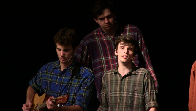 "From left, Lakeview High School students Giovonni Adrian, Brandon Marsh and Andrew Troskey sing about their lonely hearts in ""Seven Brides for Seven Brothers."""