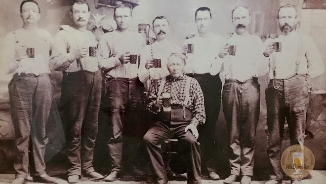 Founders of Milwaukee Brewing Co. toasted this family photo many times before finding out it was taken at the wake of a distant relative. They named their first beer, Louie's Demise Amber Ale, in his honor.
