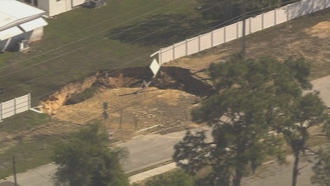 A 60-foot-wide, 35-foot-deep hole has opened in the ground near a Tarpon Springs, Fla., mobile home park.