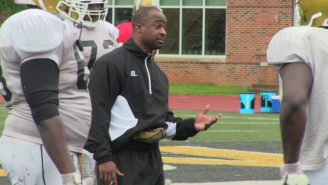Alabama State coach Brian Jenkins talks to offensive line during Friday's spring practice.