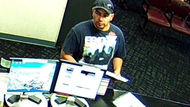 Alfonso Ismael Hernandez was identified after this photo from the GECU bank robbery was released, documents state.