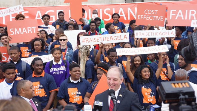 Louisiana Gov. John Bel Edwards is surrounded by high school students from Lafayette and New Orleans on the steps of the Capitol Wednesday. They rallied in support of Legislation raising the age of juvenile offenders from 17 to 18.