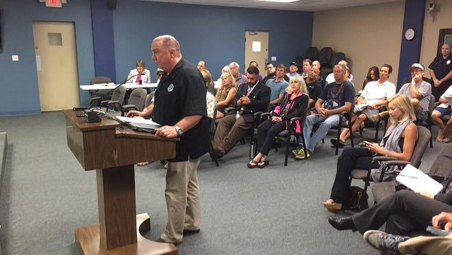 Zach Montgomery, the city's director of development services,  explains parts of a proposed ordinance regulating beach concessions Thursday night before the Cocoa Beach City Council.