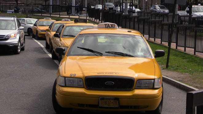 Taxis wait in line to picks up fares at the Metro-North White Plains train station on April 07, 2016.