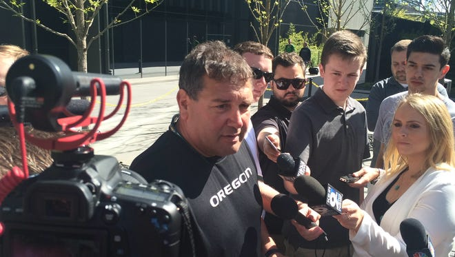 Oregon defensive coordinator Brady Hoke talks to the media on Friday after practice.