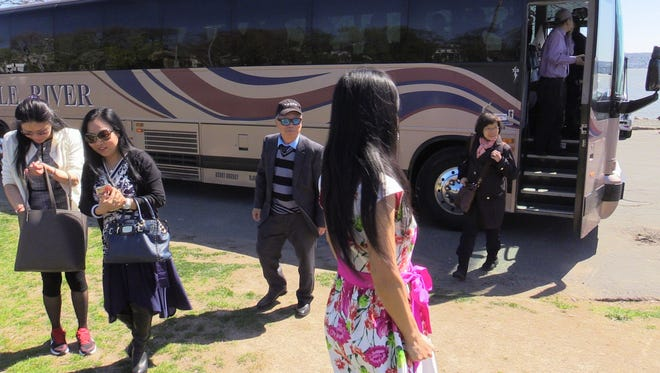 Chinese tour guides and travel agents stopped at Memorial Park in Nyack before a countywide tour of area attractions and shopping on April 20, 2016.