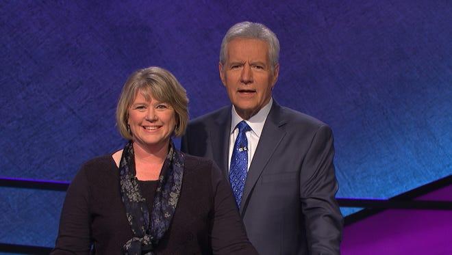 "Des Moines Public Schools teacher Jill Gilbert and ""Jeopardy!"" host Alex Trebek."