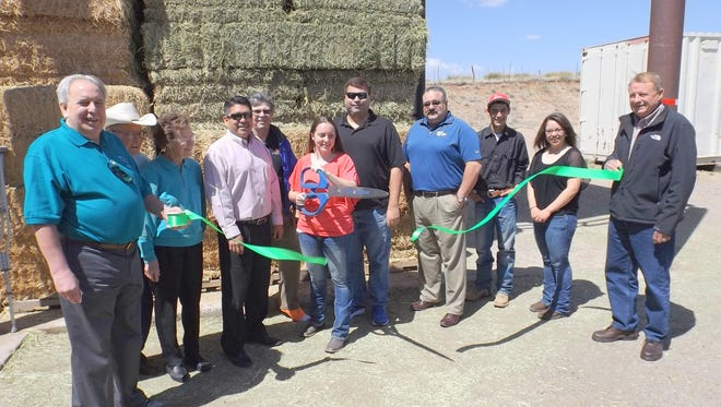 Oldham's Feed and Supply celebrates with a ribbon cutting ceremony.