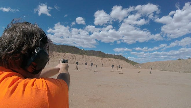 A shooter takes aim at steel targets at the Ben Avery Shooting Facility in Phoenix.