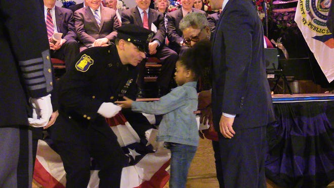 Yonkers P.O. Louis Sabatello meets Evelie Castillo, 6, for the first time after he rescued her from a car pinned under a tractor-trailer last year. The two met at during the Law Enforcement Memorial Day observance at the Westchester County Center in White Plains on May 12, 2016.  P.O. Sabatello received The Journal News Police Honor award for his action on that day.