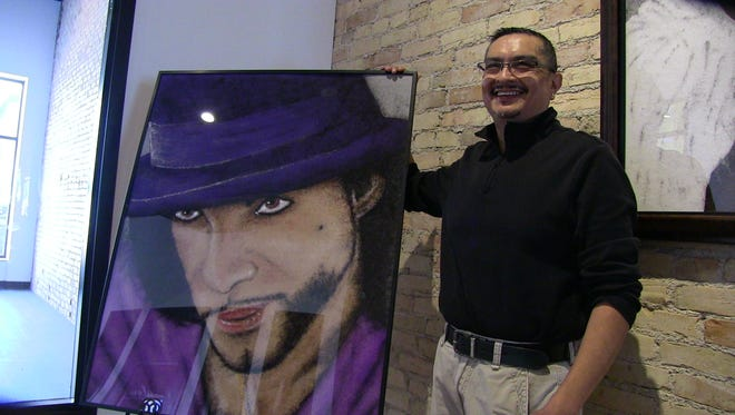 Battle Creek artist George Martinez talks about his Art Walk entry, an image of Prince made out of human hair.