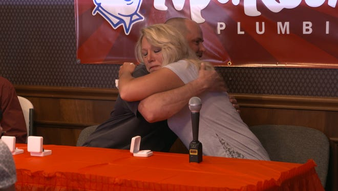 Cherie gives Trent a hug after he found her class ring that went missing in 1991.