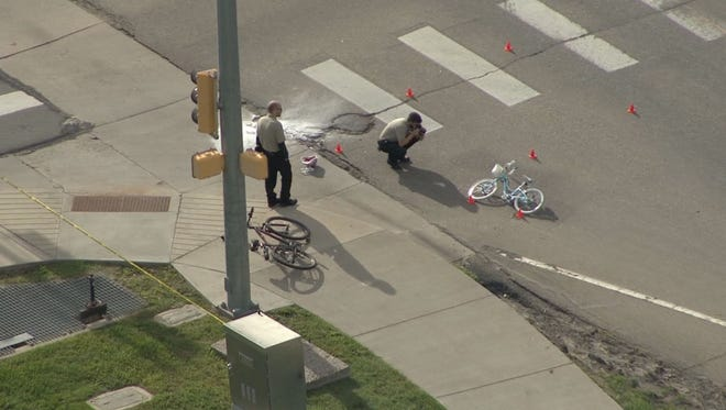 An 8-year-old girl was killed when she was hit by a truck while riding her bicycle with her stepfather.
