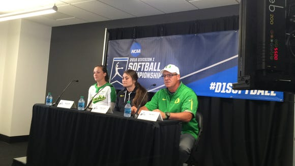 Oregon pitcher Megan Kleist (left), outfielder Koral Costa (center) and coach Mike White talk to the media Friday night after beating Fordham at the NCAA regional.