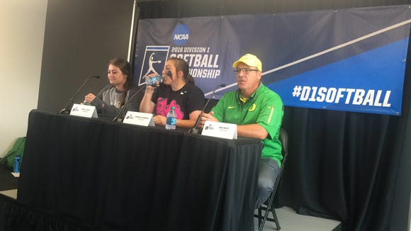 Oregon outfielder Koral Costa (left), pitcher Cheridan Hawkins (center) and coach Mike White talk to the media after beating Baylor on Saturday.