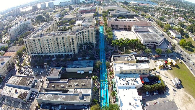 In 2015, Slide the City set up a one-day water slide attraction in West Palm Beach, Florida; on July 16, they will set up a similar slide in downtown Springfield for a block party.