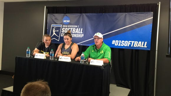 Oregon pitcher Cheridan Hawkins (left), catcher Janelle Lindvall (center) and coach Mike White talk to the media Saturday after beating UCLA.