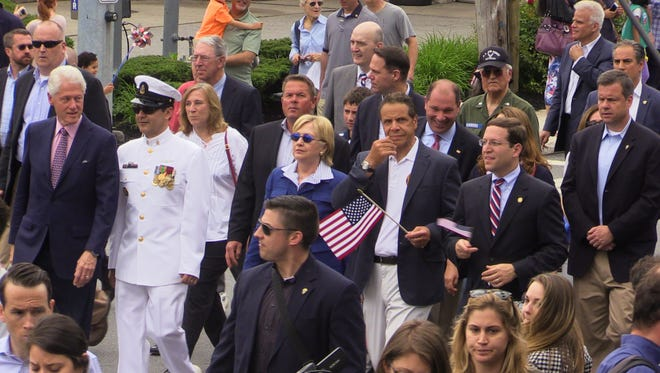 Bill and Hillary Clinton and Gov. Andrew Cuomo march in the Chappaqua Memorial Day parade, May 30, 2016.