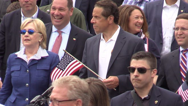 Presidential hopeful Hillary Clinton marched in Memorial Day Parade in Chappaqua with New York State Governor Andrew Cuomo and her husband Bill Clinton on May 30, 2016.