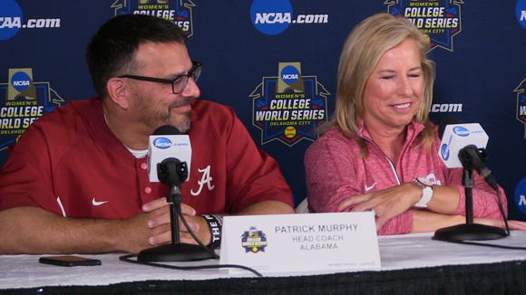 Alabama coach Patrick Murphy and Oklahoma coach Patty Gasso share a laugh during Wednesdays' press conference heading into the 2016 Women's College World Series in Oklahoma City, Okla.