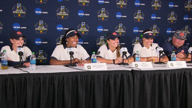 Auburn players (l to r)  Kasey Cooper, Jade Rhodes, Emily Carosone, Kaylee Carlson and coach  Clint Meyers talk about the Tigers' 10-3 win over UCLA in the Women's College World Series in Oklahoma City, Okla.