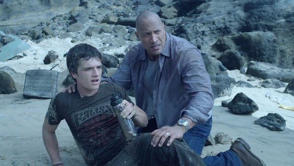 "Josh Hutcherson (left) and Dwayne Johnson face a variety of obstacles in ""Journey 2: The Mysterious Island."""
