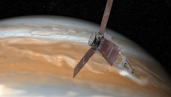 An undated handout image made available by NASA shows an artist's rendering of NASA's Juno spacecraft making one of its close passes over Jupiter.