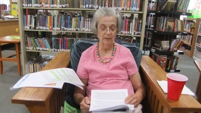 Retired librarian Marie Kaplan joins the discussion of a book at a recent  Swannanoa Library Book Club meeting.