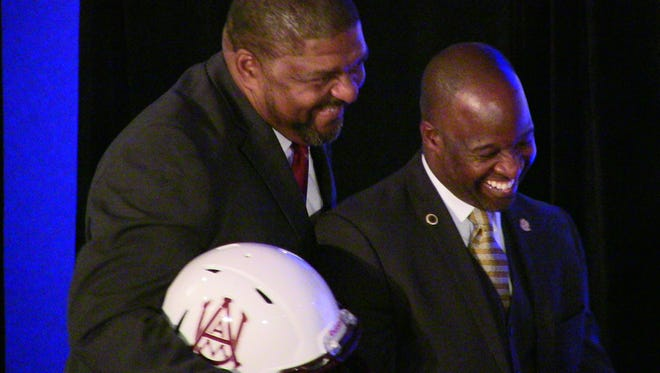 Alabama State coach Brian Jenkins shares a laugh with Alabama A&M coach James Spady Friday at SWAC Media Day in Birmingham.