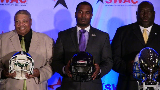 Standing between Mississippi Valley State coach Rick Comegy and Southern coach Dawson Odums, Prairie View A&M coach Willie Simmons led the Panthers to a 8-2 record in his first season as head coach last year.