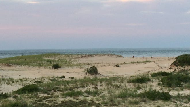 The ocean at the Point of Cape Henlopen is shown. The ocean leads to the entrance of the Delaware Bay shipping channel.