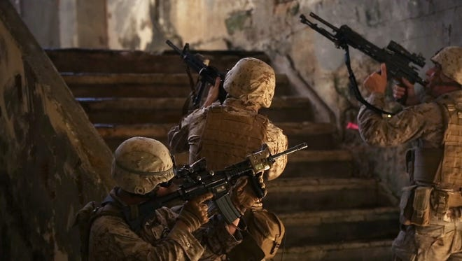U.S. Marines make their way upstairs Sept. 20, 2014, in Tinian,during an island seizure exercise as part of Valiant Shield 2014.