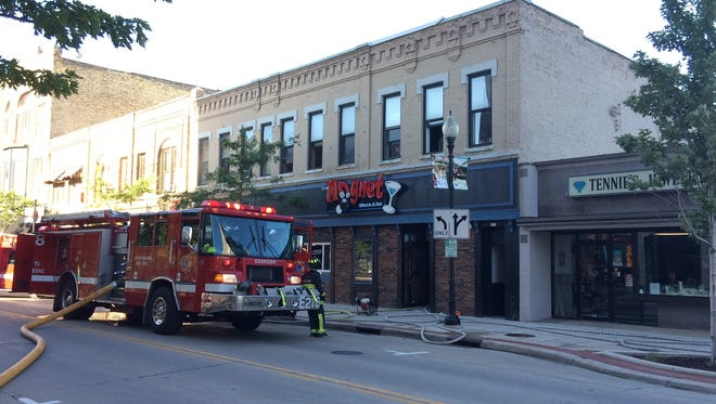 Oshkosh emergency crews respond Friday to a possible early morning fire at Magnet Bar & Billiards, 519 N. Main St.