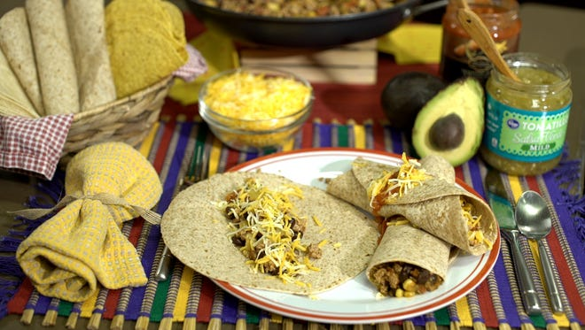 Hot and spicy burrito meat with only eight ingredients and ready in under fifteen minutes.