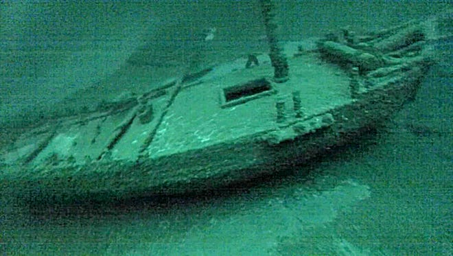 """This July 16, 2016, photo taken from underwater  video  shows the """"Washington"""", which sank during a storm in 1803. The team of underwater explorers says it has found the second-oldest confirmed shipwreck in the Great Lakes, an American-built, Canadian owned-sloop that sank in Lake Ontario 213 years ago. The three-member western New York-based team says it discovered the wreck of the Washington earlier this summer in deep water off Oswego. (Roger L. Pawlowski via AP)"""