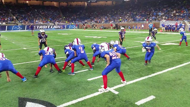 The Port Huron JV Bills line up for a play at Ford Field on Aug. 18, 2016. The Bills had the chance to play during halftime of the Lions preseason game against the Cincinnati Bengals.