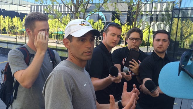 Oregon offensive coordinator Matt Lubick talks to the media after practice.