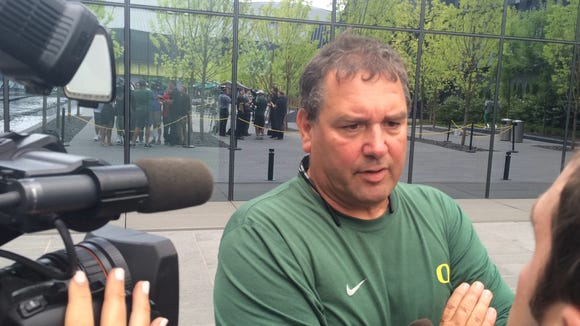 Oregon defensive coordinator Brady Hoke talks to reporters on media day earlier this month.